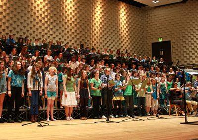 John Miles conducting choir